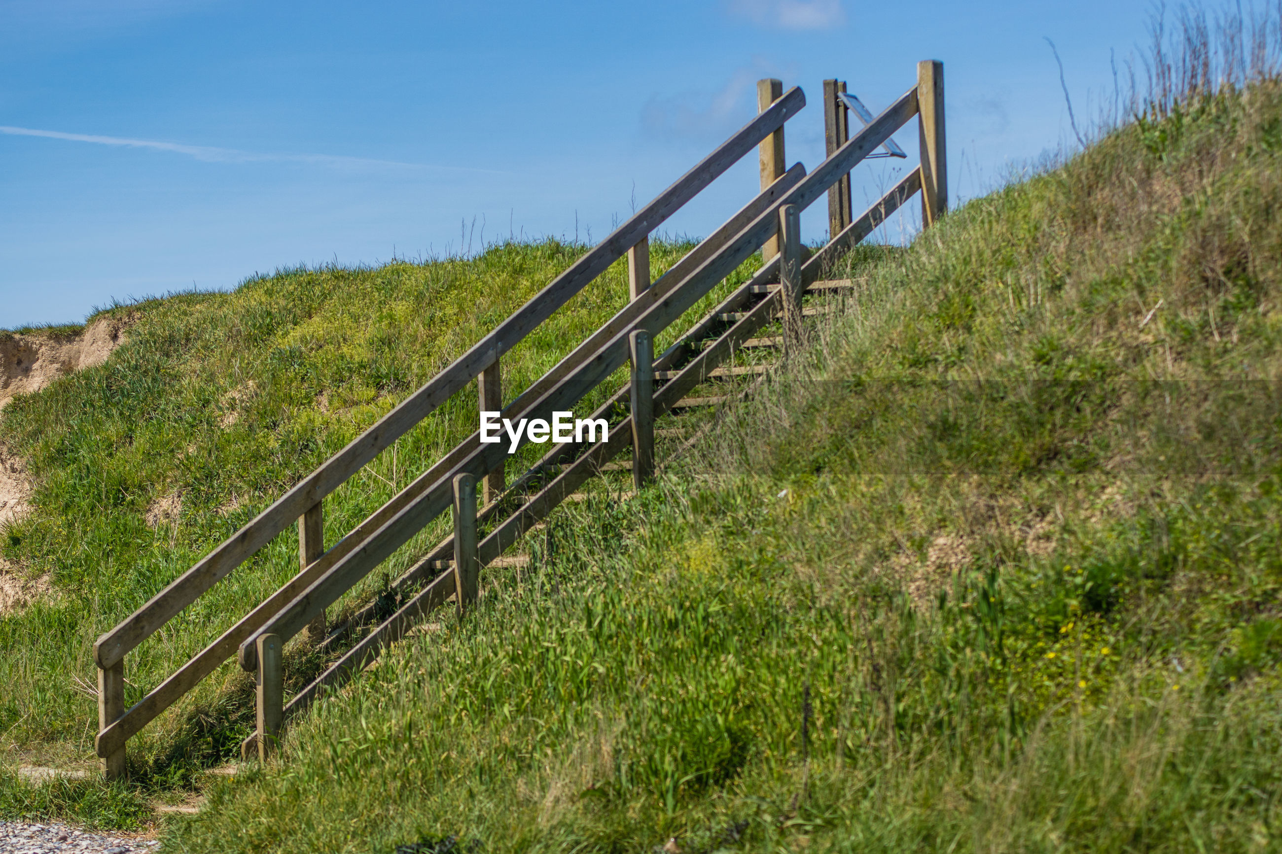 STEPS LEADING TO GRASS AGAINST SKY