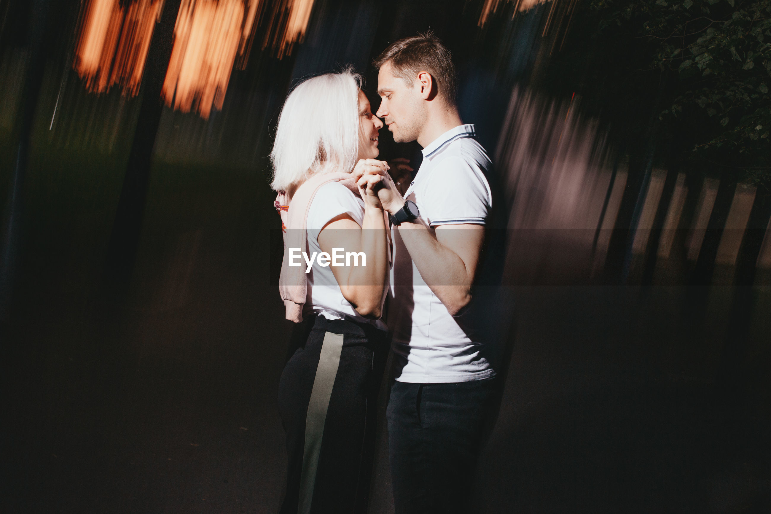 Romantic couple standing against blurred background