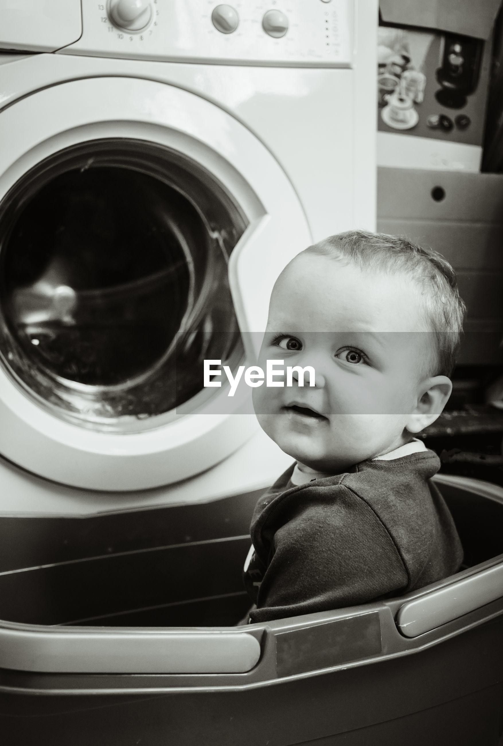 PORTRAIT OF CUTE BOY IN MACHINE PART