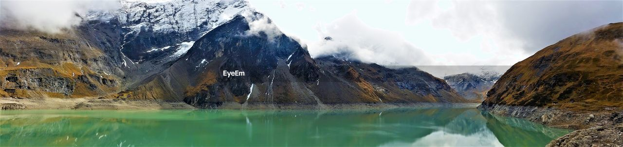 mountain, snow, cold temperature, nature, scenics, tranquil scene, beauty in nature, water, lake, tranquility, no people, day, waterfront, winter, mountain range, outdoors, sky, iceberg
