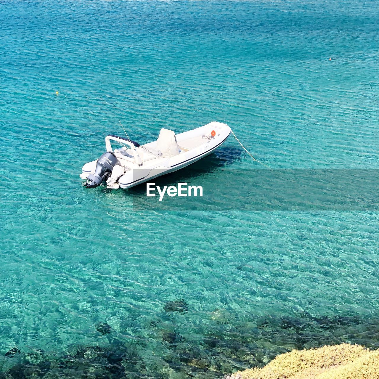 water, nautical vessel, mode of transportation, sea, transportation, waterfront, day, blue, nature, moored, no people, beauty in nature, tranquility, high angle view, scenics - nature, outdoors, turquoise colored, tranquil scene, travel, inflatable