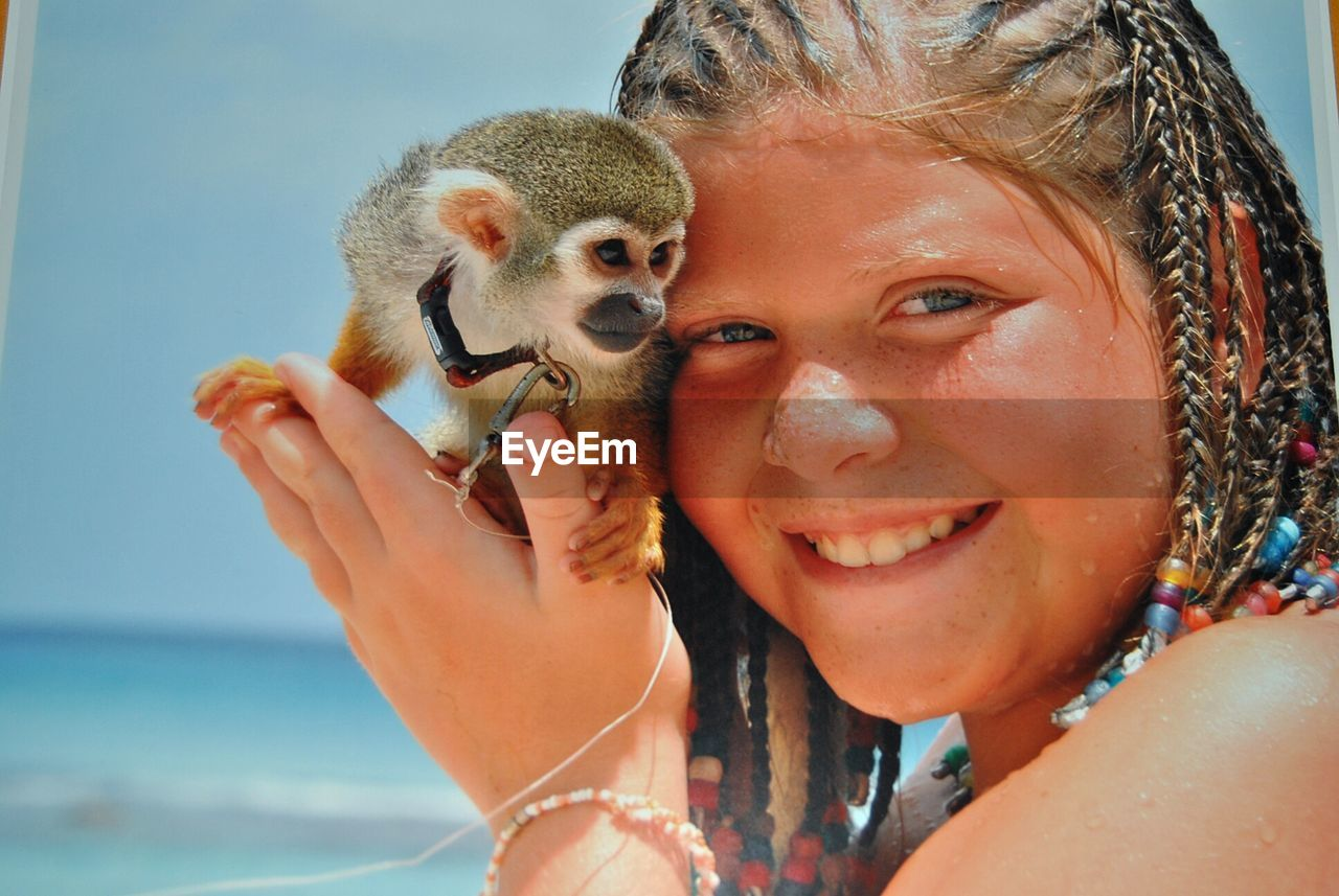 Close-Up Of Woman Holding Monkey