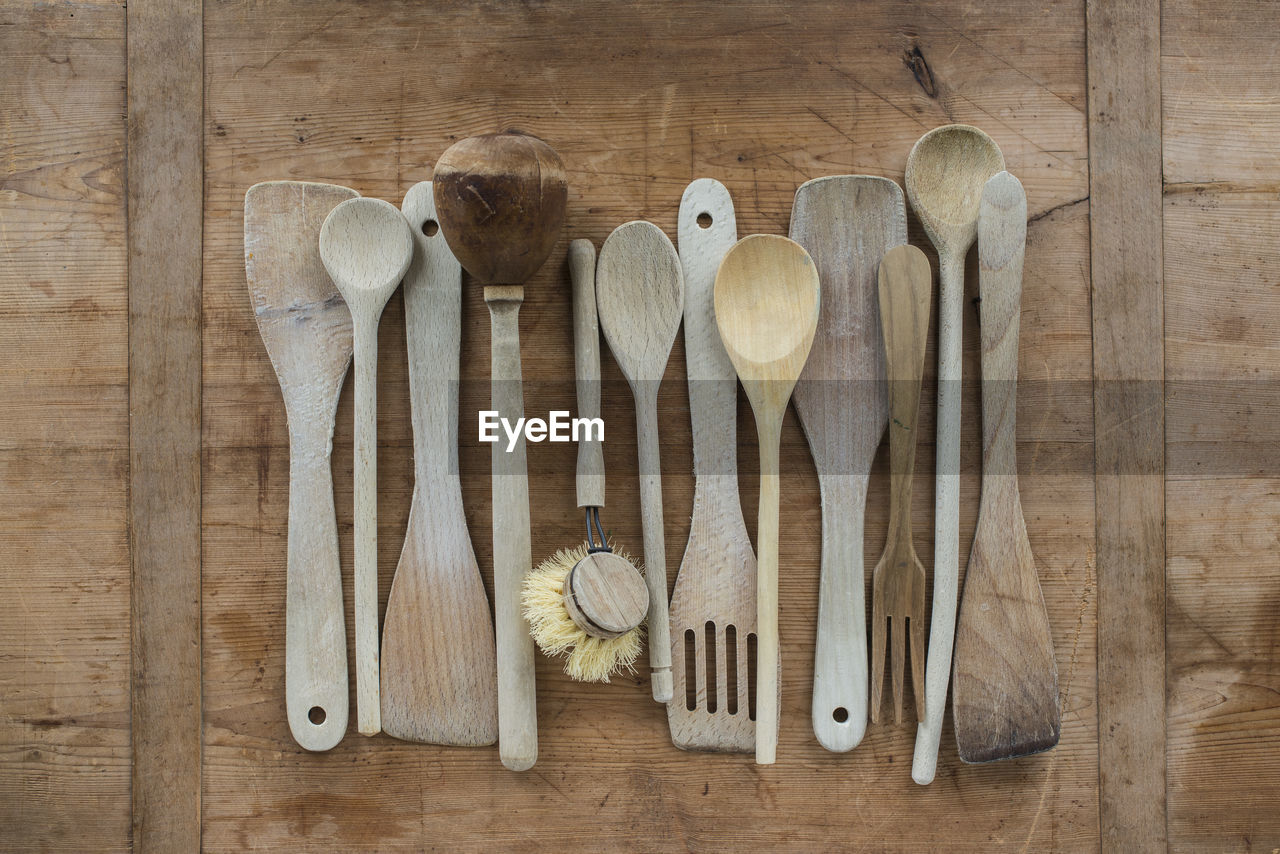Directly Above Shot Of Wooden Kitchen Utensils On Table