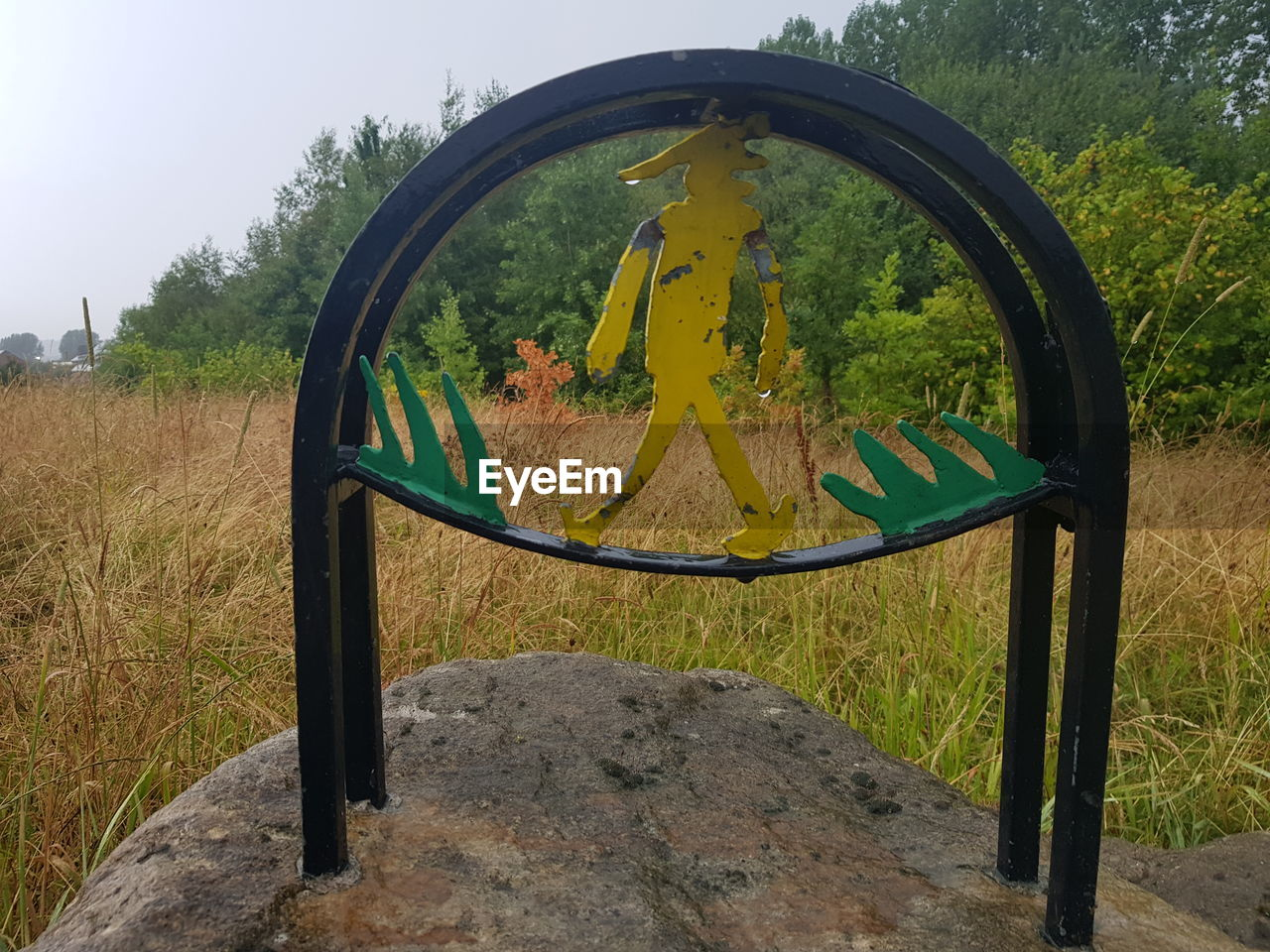 plant, tree, day, nature, no people, geometric shape, circle, yellow, shape, green color, sky, metal, outdoors, field, playground, park, land, arch, glass - material, seat, outdoor play equipment, wheel
