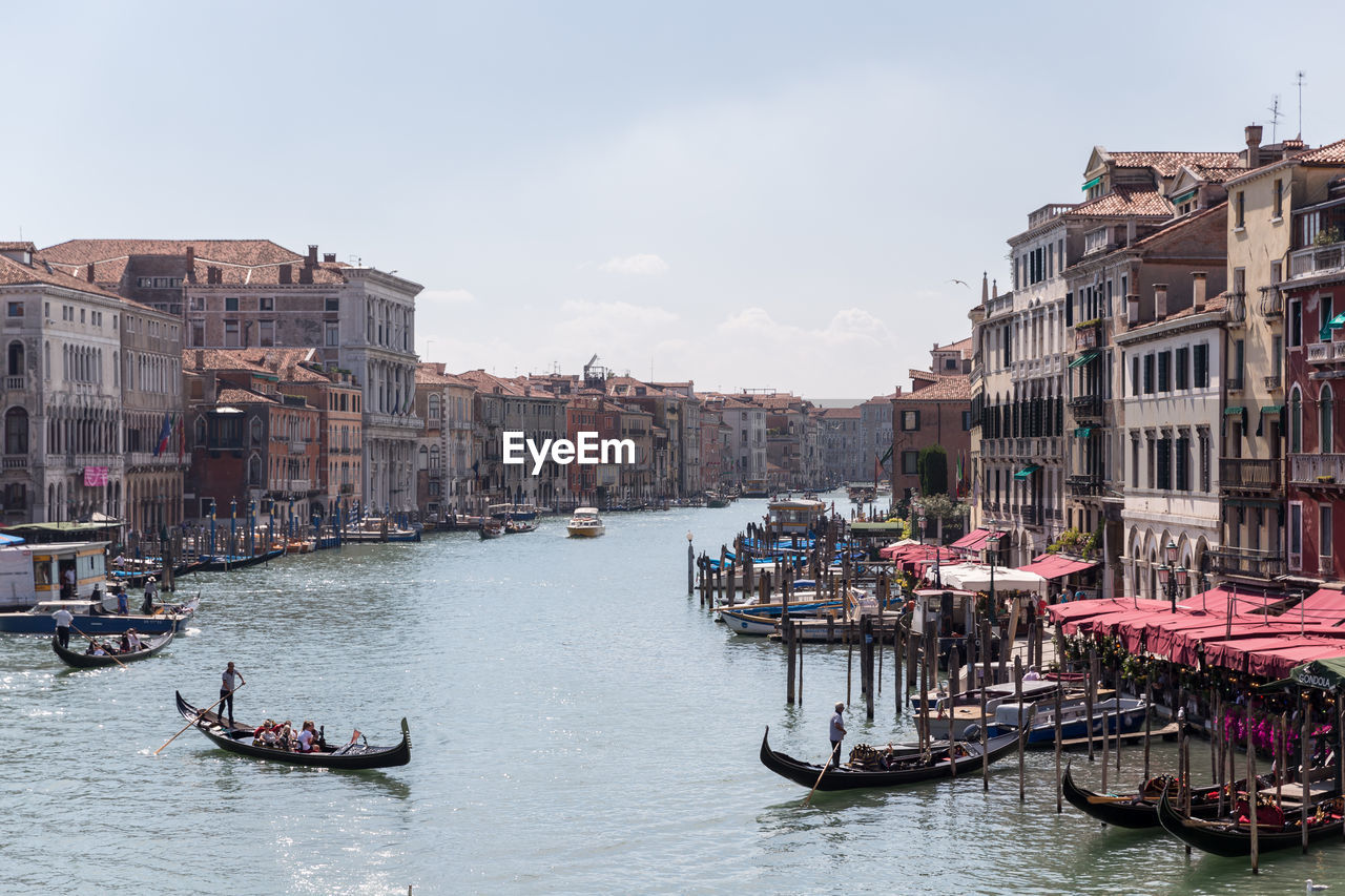 Gondolas In Grand Canal Amidst Buildings