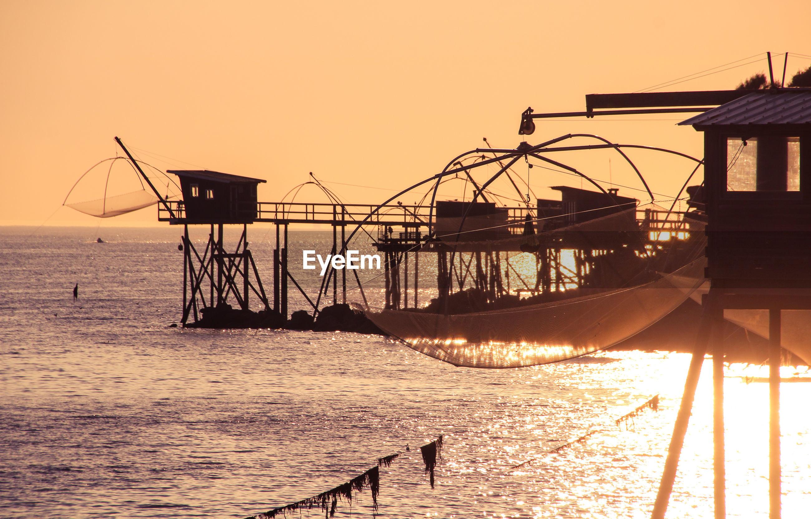 SILHOUETTE SAILBOATS ON SEA AGAINST CLEAR SKY