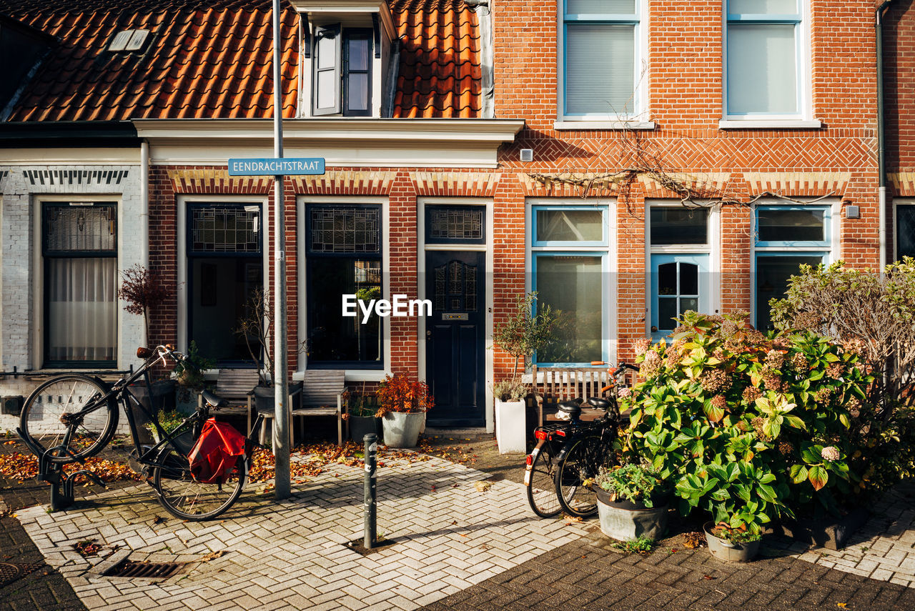 architecture, building exterior, built structure, building, window, city, plant, street, seat, sidewalk, chair, footpath, nature, cafe, day, table, no people, outdoors, residential district, potted plant, luxury