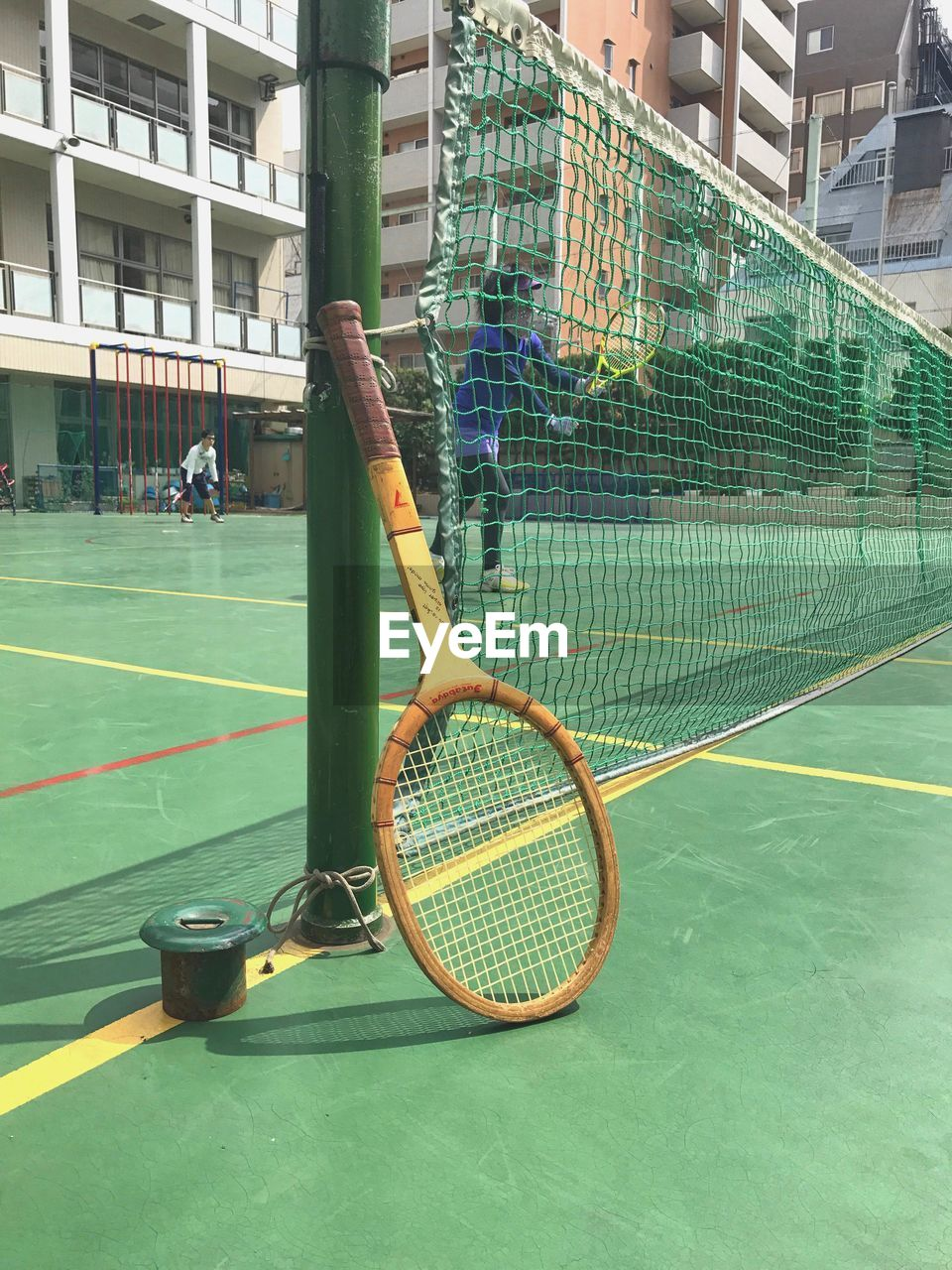 sport, tennis, court, racket, tennis racket, tennis ball, net - sports equipment, day, playing, ball, architecture, built structure, leisure activity, real people, racket sport, tennis net, outdoors, building exterior, people, competition