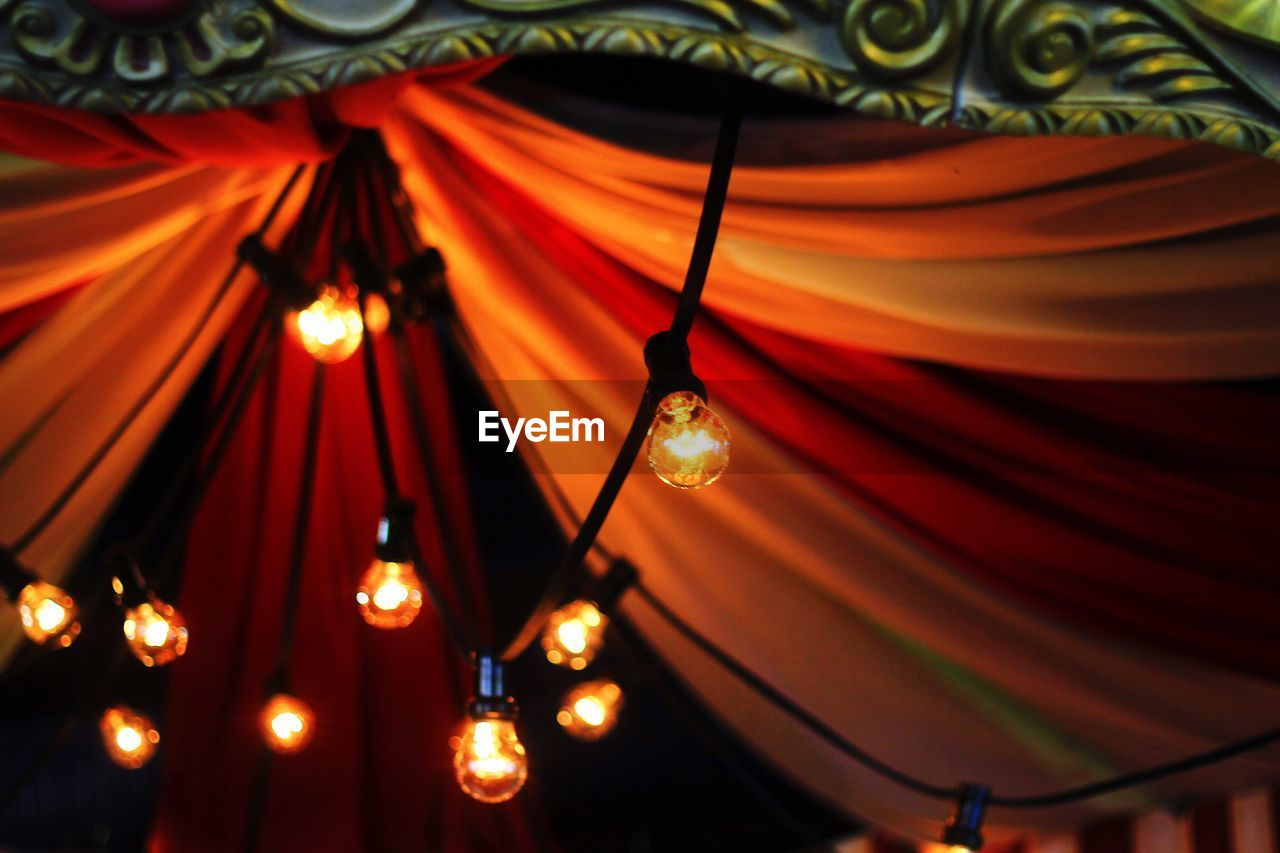 illuminated, indoors, low angle view, hanging, curtain, no people, close-up, night