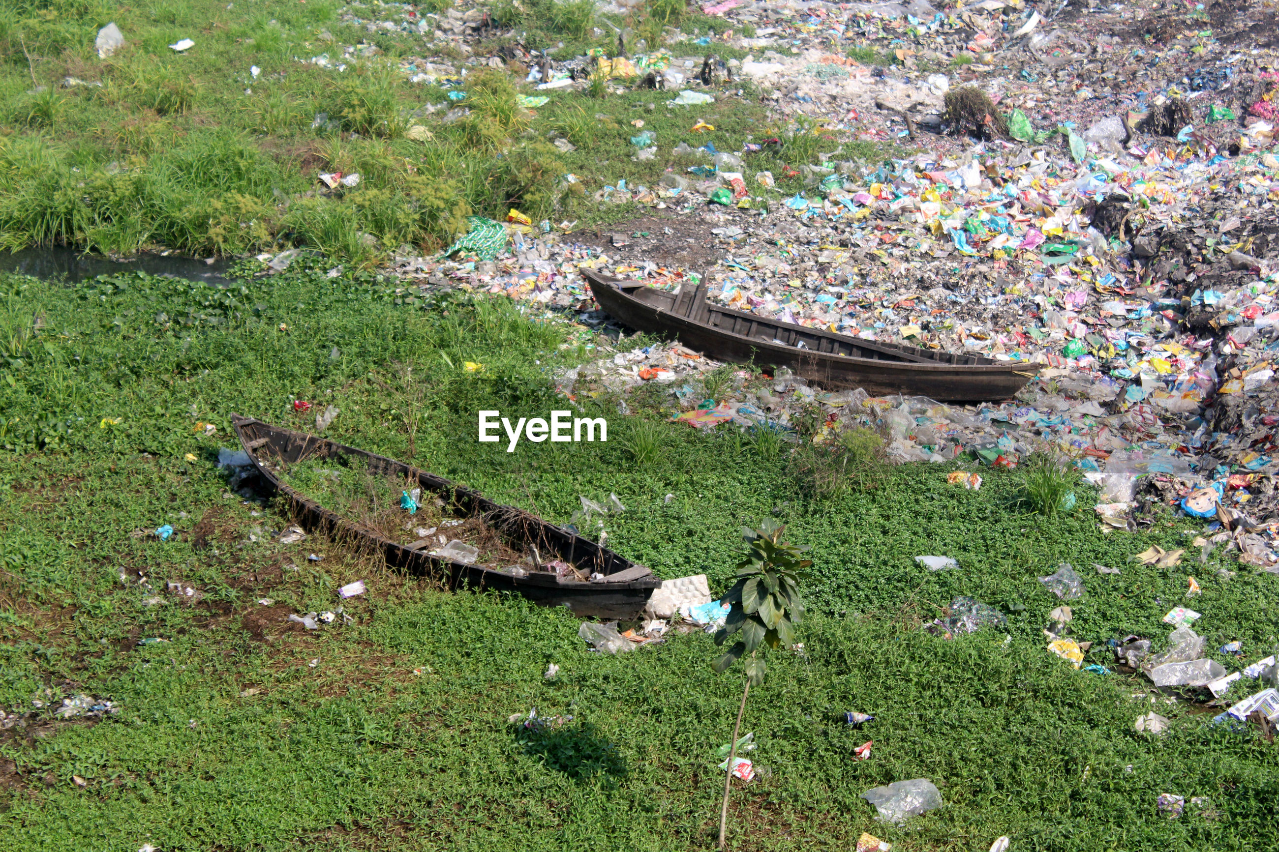 High angle view of boat and garbage on land
