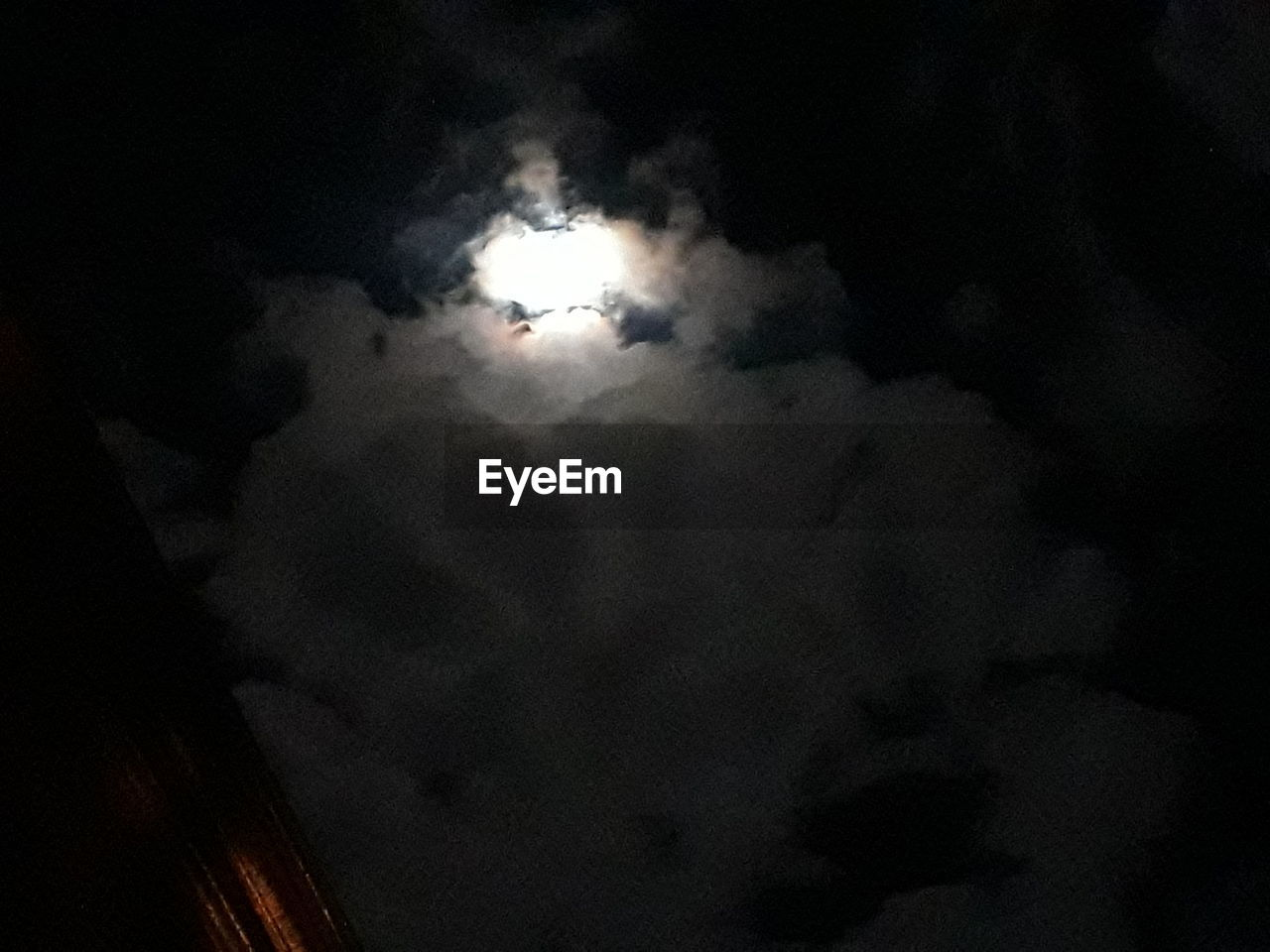 cloud - sky, sky, night, low angle view, no people, beauty in nature, scenics - nature, moon, nature, tranquility, outdoors, dark, tranquil scene, moonlight, cloudscape, dramatic sky, overcast, space, majestic, ominous