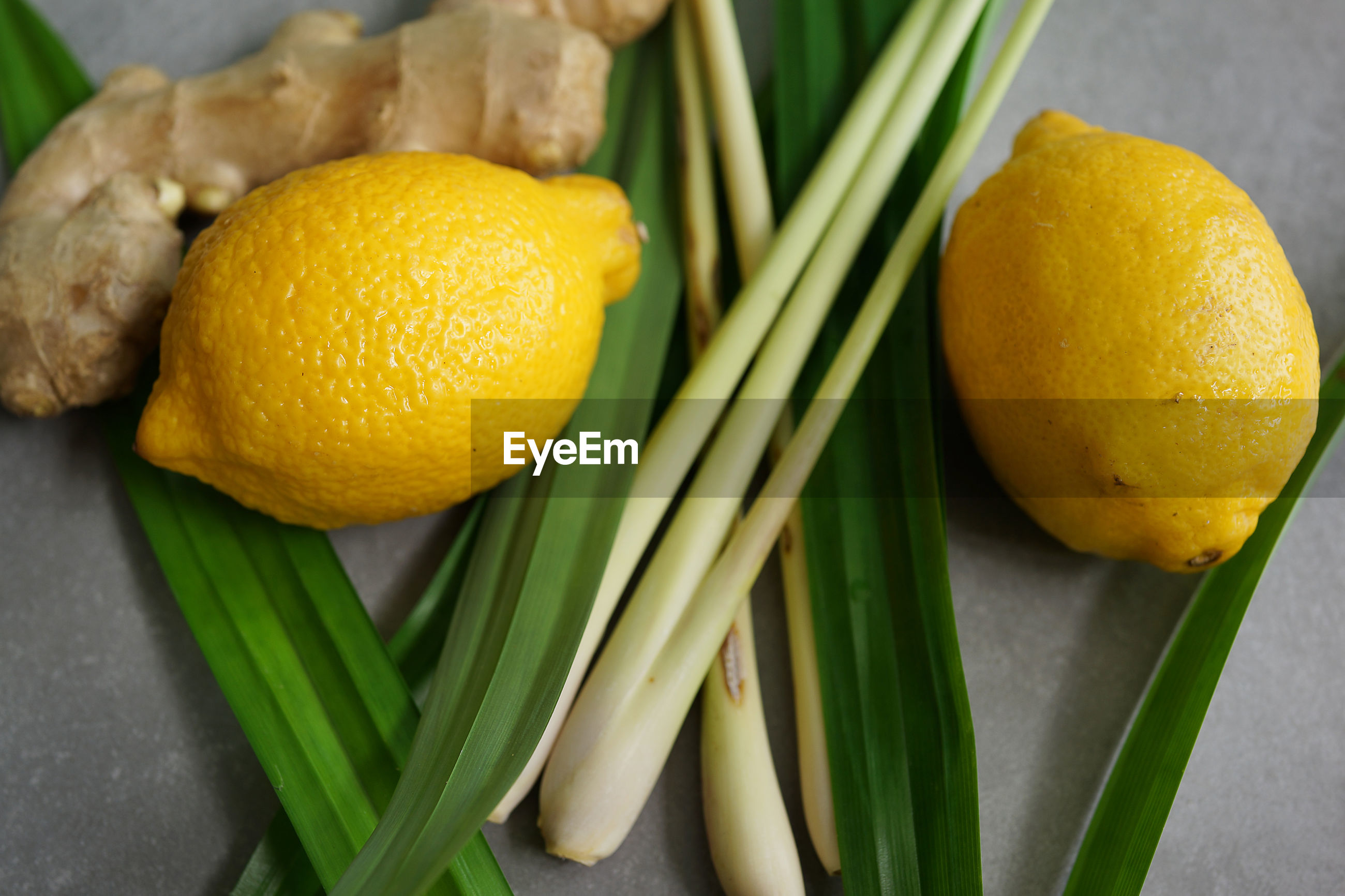 High angle view of lemon with ginger and vegetables on table