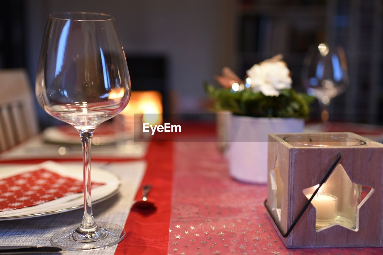 table, food and drink, glass, wineglass, alcohol, wine, refreshment, freshness, focus on foreground, drink, no people, still life, indoors, food, place setting, drinking glass, glass - material, tablecloth, household equipment, restaurant, setting, luxury
