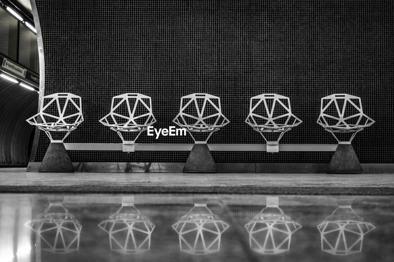 no people, pattern, indoors, basketball - sport, sport, flooring, built structure, design, reflection, side by side, close-up, architecture, shape, night, geometric shape, leisure games, creativity, circle, nature, ball