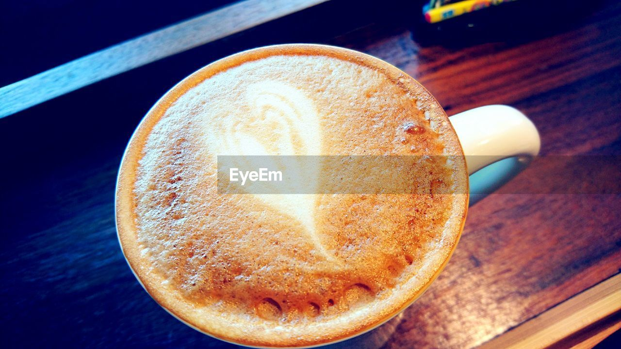 coffee - drink, drink, coffee cup, food and drink, frothy drink, refreshment, table, cappuccino, freshness, froth, close-up, latte, froth art, cup, no people, high angle view, indoors, food, day