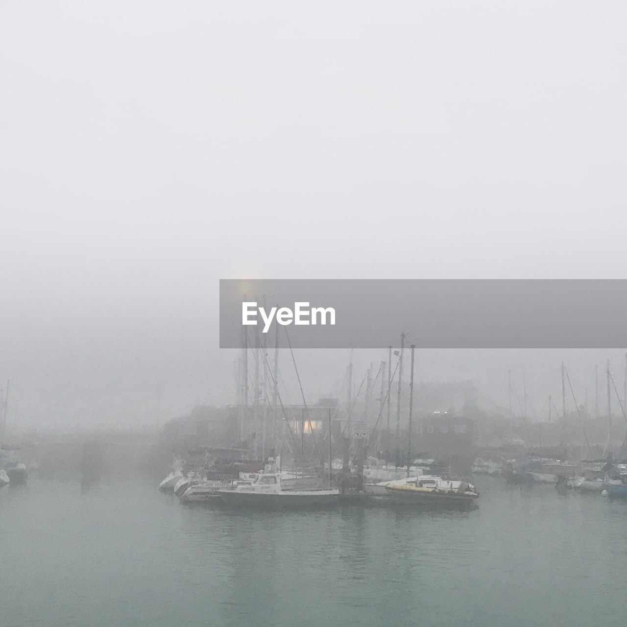 SAILBOATS IN SEA DURING FOGGY WEATHER
