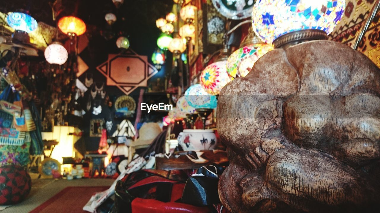for sale, variation, large group of objects, no people, retail, statue, multi colored, illuminated, indoors, day, close-up