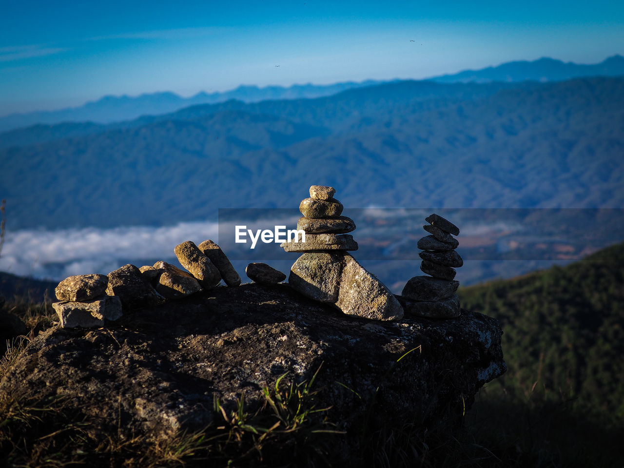 mountain, rock, solid, scenics - nature, sky, tranquil scene, rock - object, nature, tranquility, beauty in nature, no people, non-urban scene, environment, mountain range, day, landscape, stack, remote, focus on foreground, balance, outdoors, mountain peak