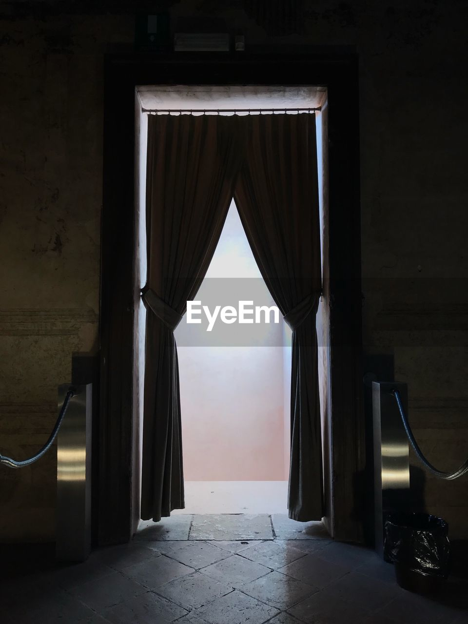 Empty entrance into corridor of building with curtain