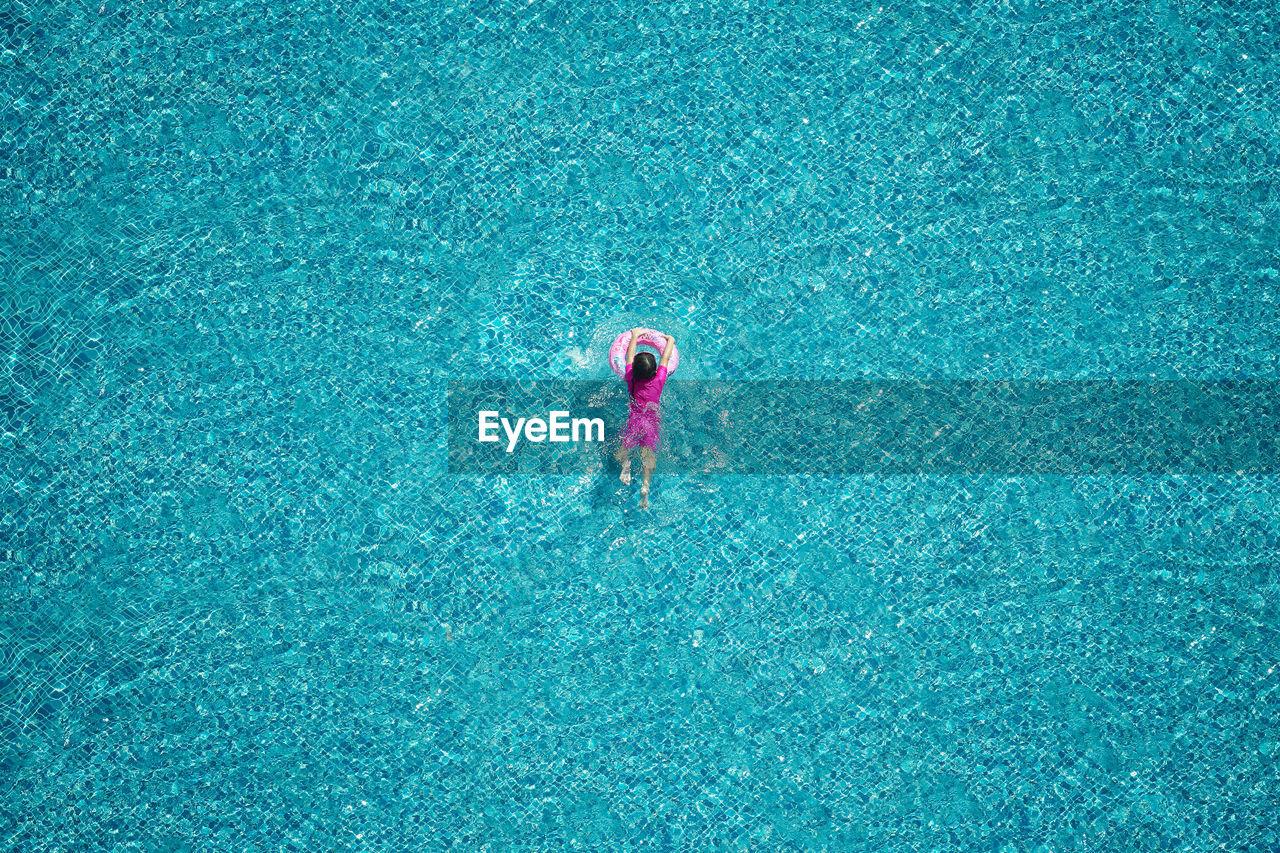 High Angle View Of Child In Swimming Pool