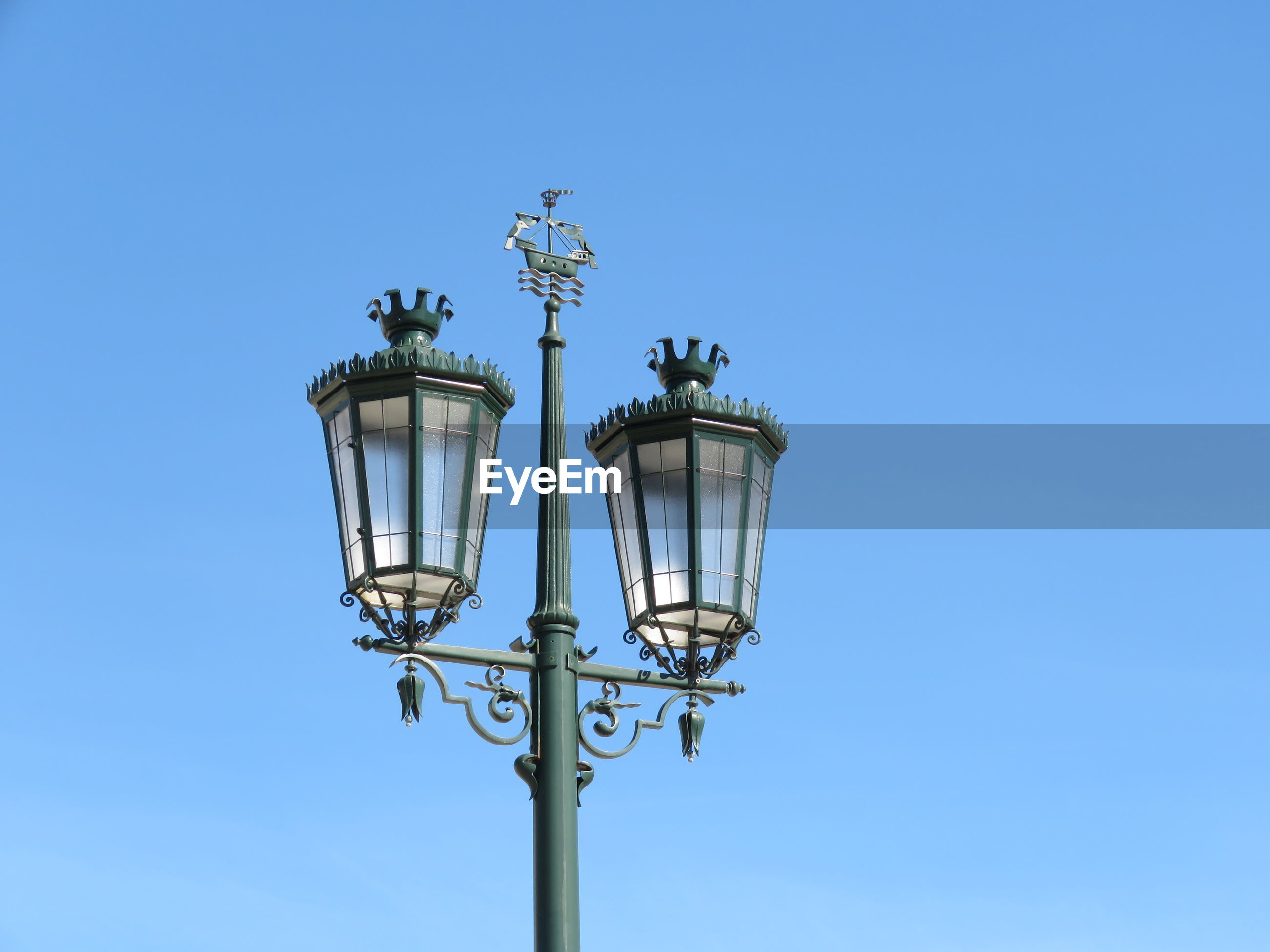 Low angle view of lamp post against clear sky