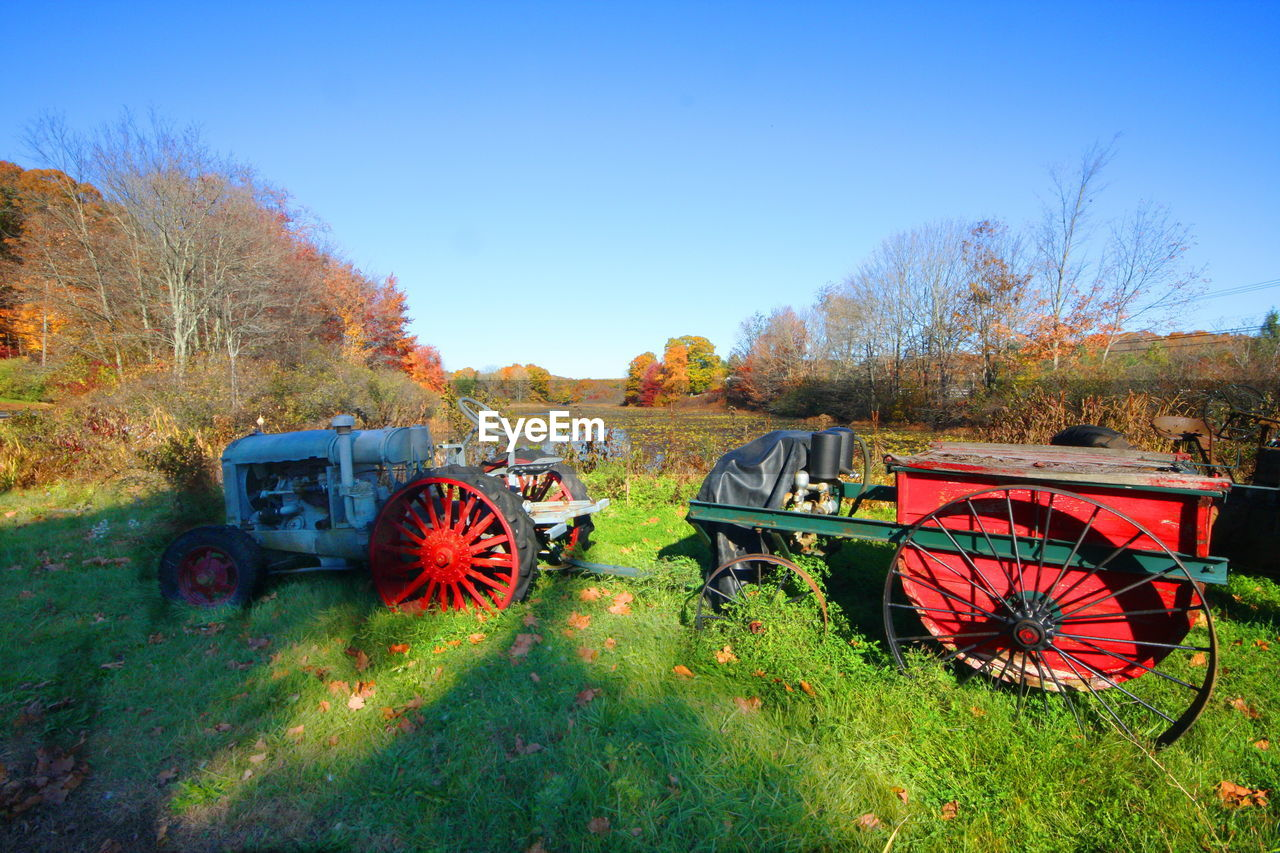 Tractor On Grassy Field During Autumn