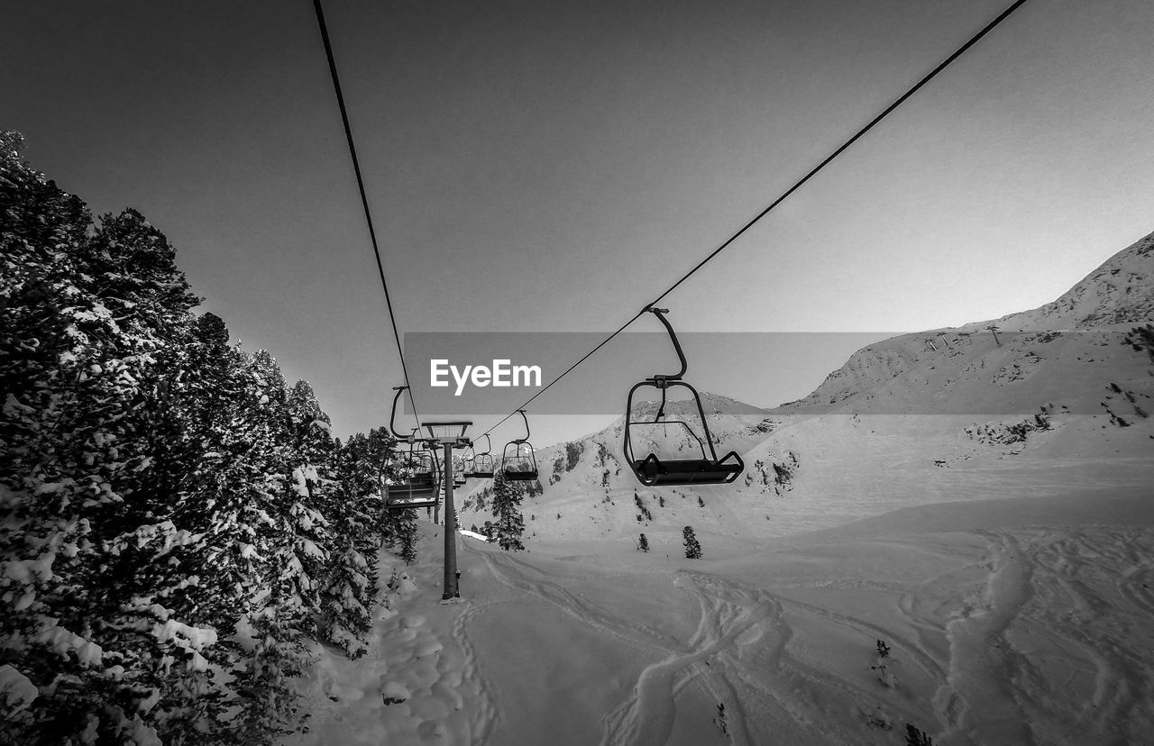 winter, snow, nature, cold temperature, weather, ski lift, beauty in nature, overhead cable car, cable, day, scenics, outdoors, tranquil scene, tranquility, transportation, mountain, ski holiday, landscape, real people, sky, tree