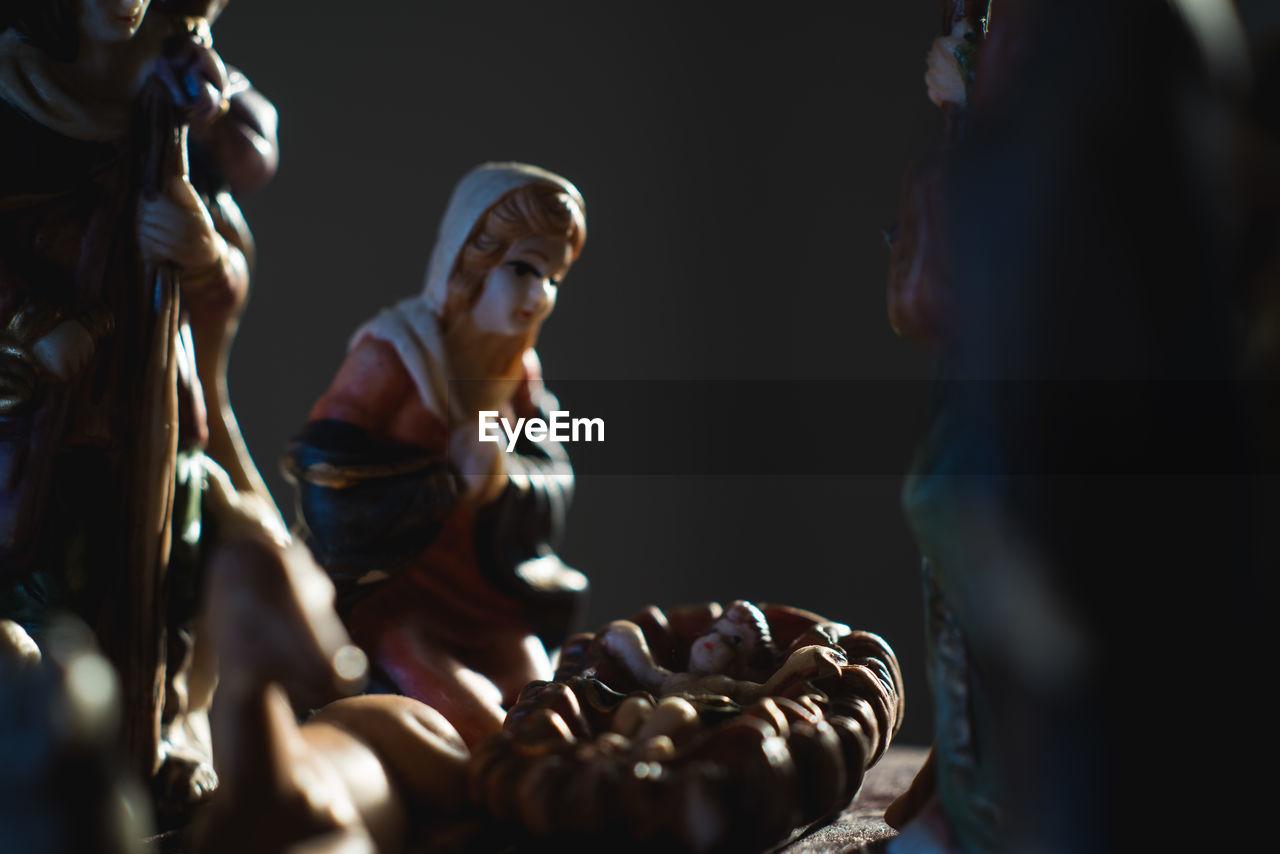 Close-Up Of Nativity Scene In Darkroom