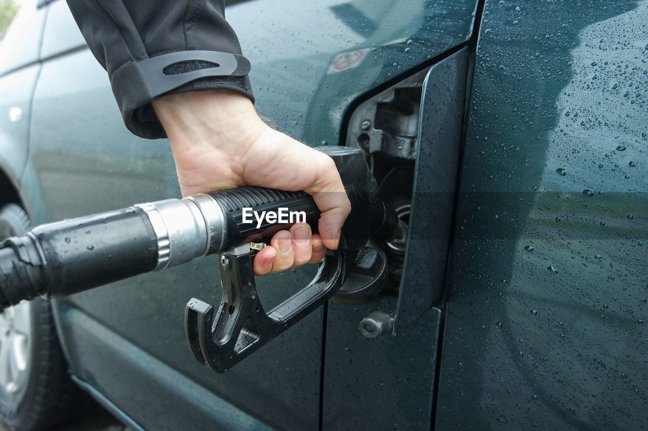 Cropped hand refueling car
