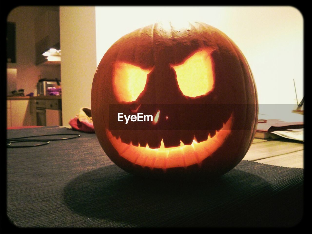 pumpkin, halloween, celebration, anthropomorphic face, jack o lantern, indoors, home interior, illuminated, no people, table, spooky, holiday - event, jack o' lantern, close-up, day