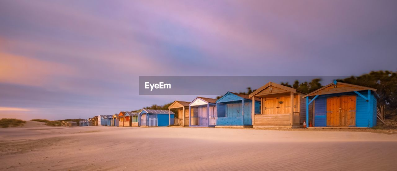 architecture, built structure, building exterior, sky, land, cloud - sky, building, sand, beach, nature, house, no people, scenics - nature, tranquility, beauty in nature, residential district, outdoors, tranquil scene, sunset, beach hut
