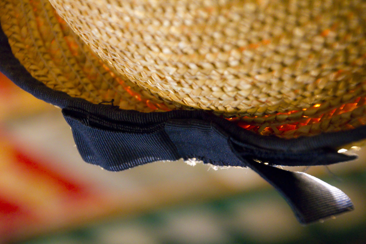 basket, hat, focus on foreground, whicker, outdoors, close-up, hanging, no people, day