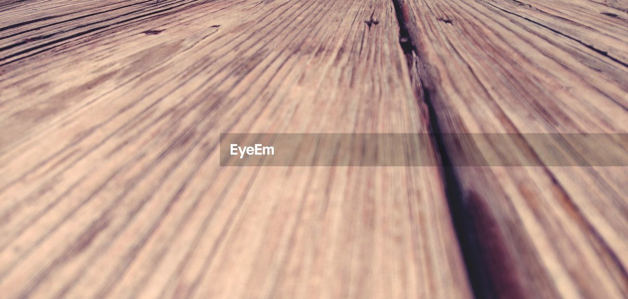 full frame, wood - material, pattern, backgrounds, textured, no people, close-up, brown, wood, wood grain, day, indoors, plank, flooring, selective focus, nature, high angle view, abstract, rough, textured effect