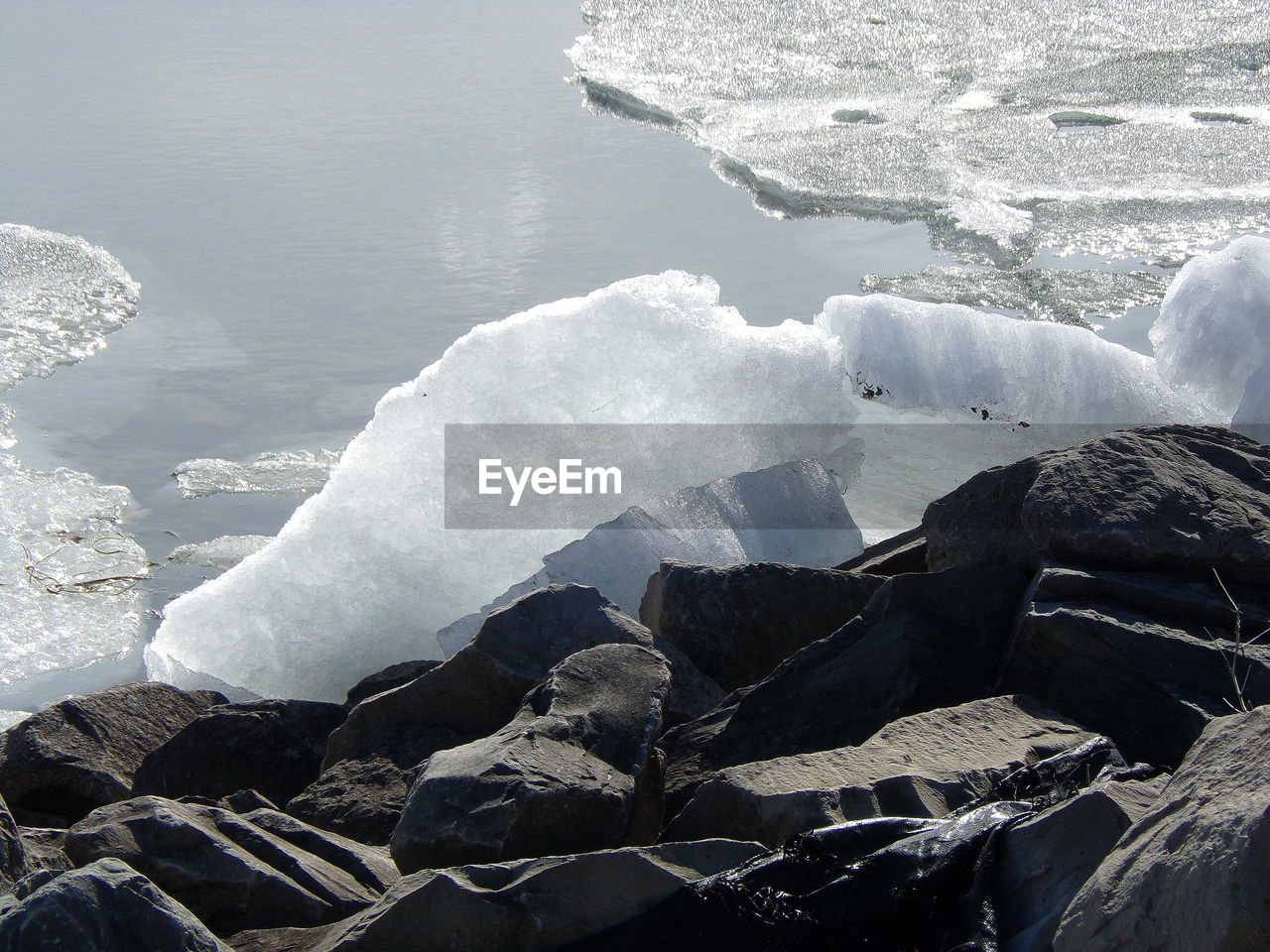 water, rock, sea, day, beauty in nature, nature, solid, frozen, ice, rock - object, no people, winter, cold temperature, scenics - nature, tranquility, snow, tranquil scene, outdoors, iceberg, melting, flowing water