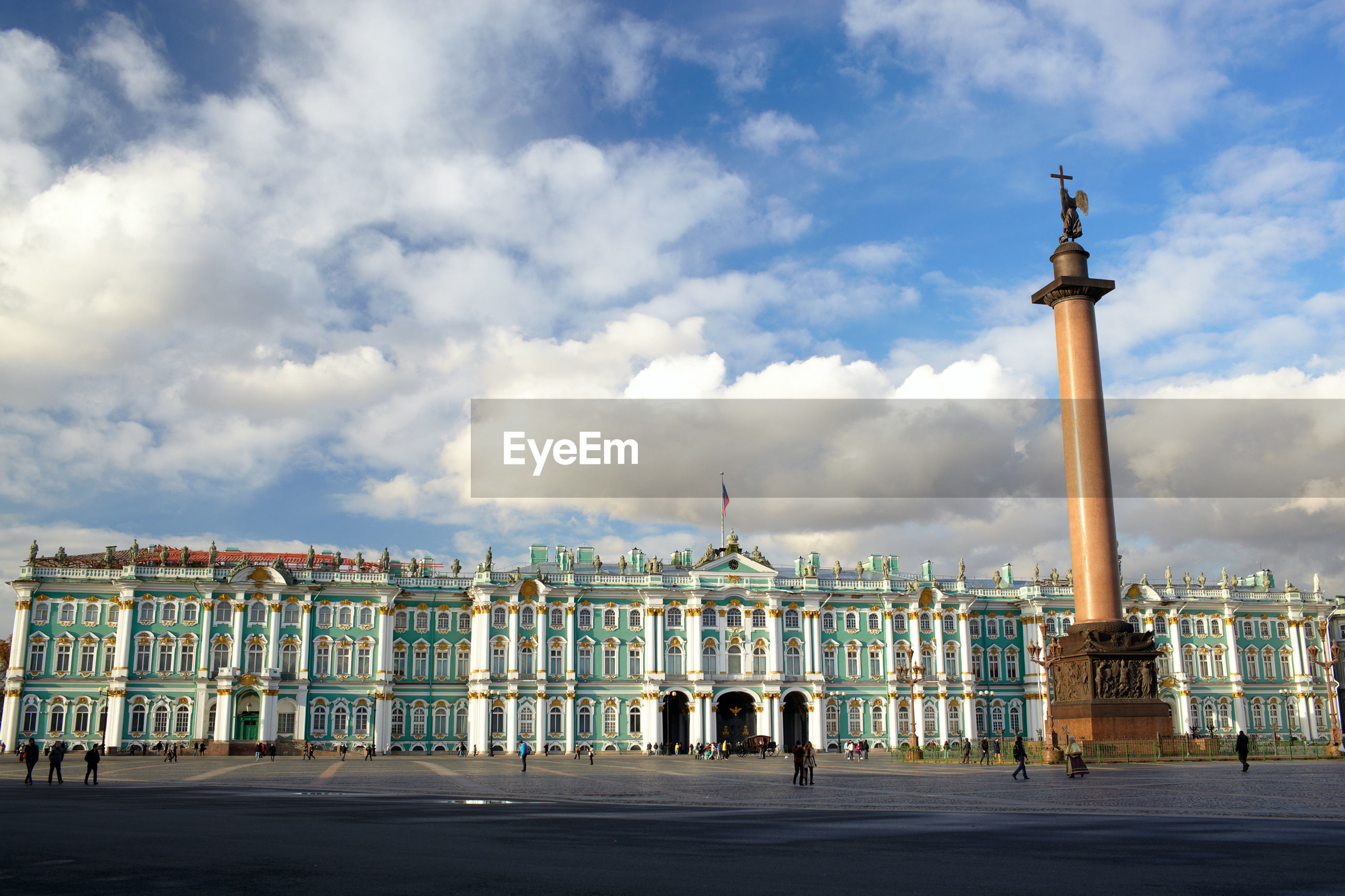 Alexander column and winter palace against sky