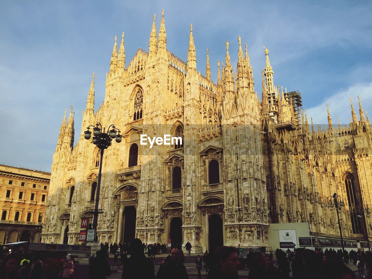 building exterior, architecture, built structure, crowd, group of people, sky, travel destinations, tourism, religion, large group of people, place of worship, travel, belief, building, spirituality, real people, history, gothic style, ornate