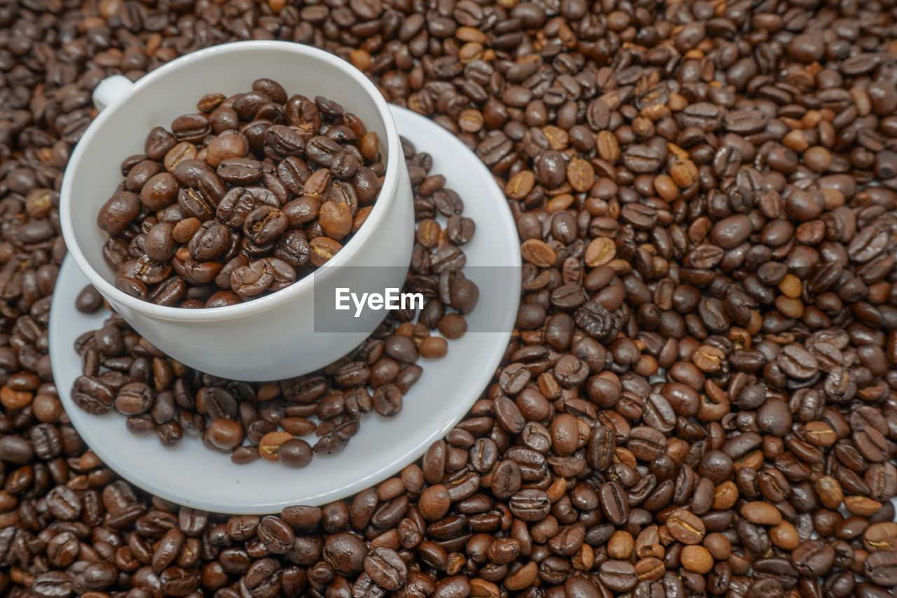food and drink, food, roasted coffee bean, coffee, coffee - drink, freshness, brown, large group of objects, still life, indoors, abundance, high angle view, coffee bean, cup, drink, no people, refreshment, table, close-up, heap, crockery, caffeine