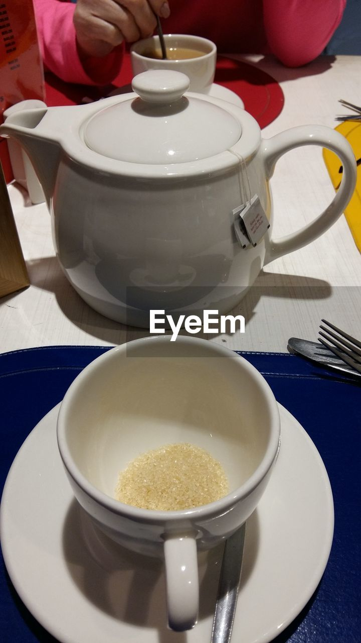 food and drink, coffee cup, drink, cup, refreshment, saucer, coffee - drink, table, indoors, food, freshness, high angle view, plate, tea - hot drink, healthy eating, teapot, close-up, no people, frothy drink, day