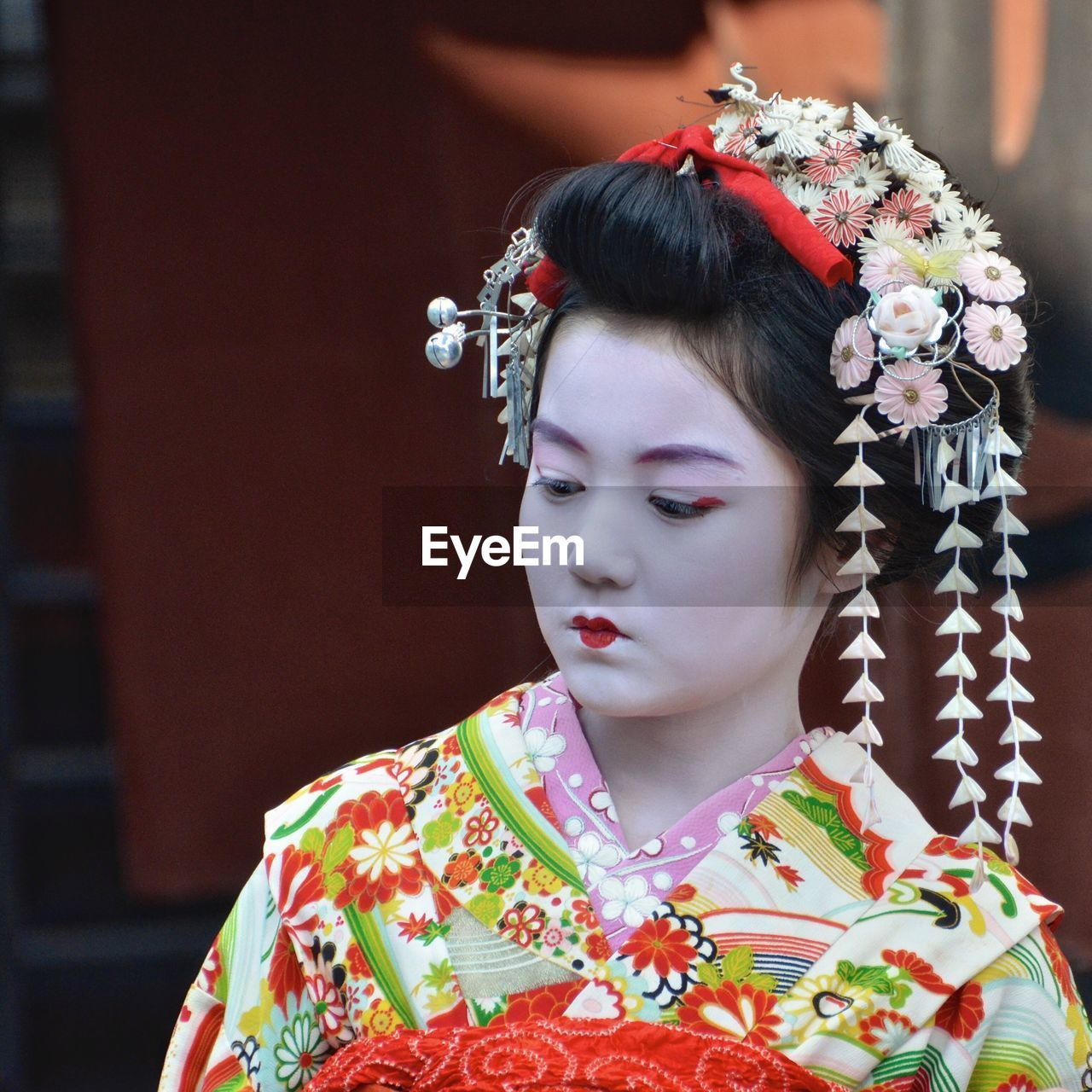 real people, wearing flowers, one person, traditional clothing, girls, focus on foreground, lifestyles, kimono, front view, outdoors, celebration, childhood, day, flower, close-up, young adult, bride