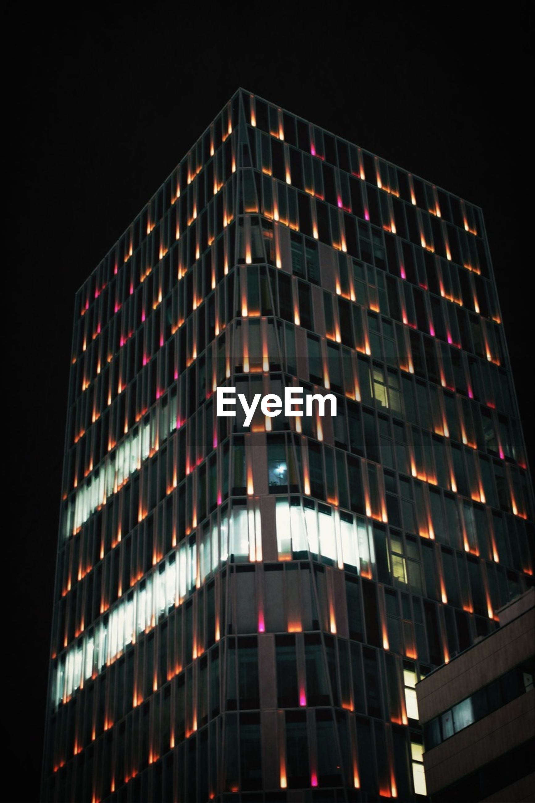 architecture, building exterior, low angle view, built structure, night, illuminated, city, modern, building, office building, skyscraper, window, tall - high, sky, tower, clear sky, no people, residential building, outdoors, residential structure