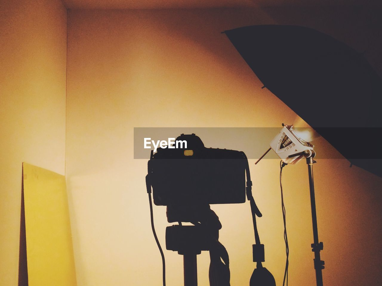 Professional camera against yellow walls