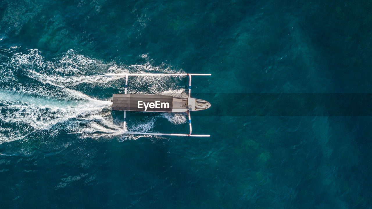 Drone View Of Boat Sailing On Sea