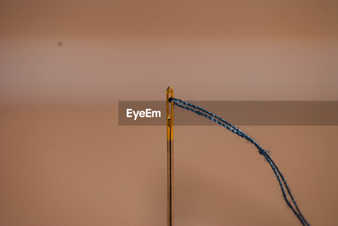 Close-Up Of Eye Of Needle And Thread
