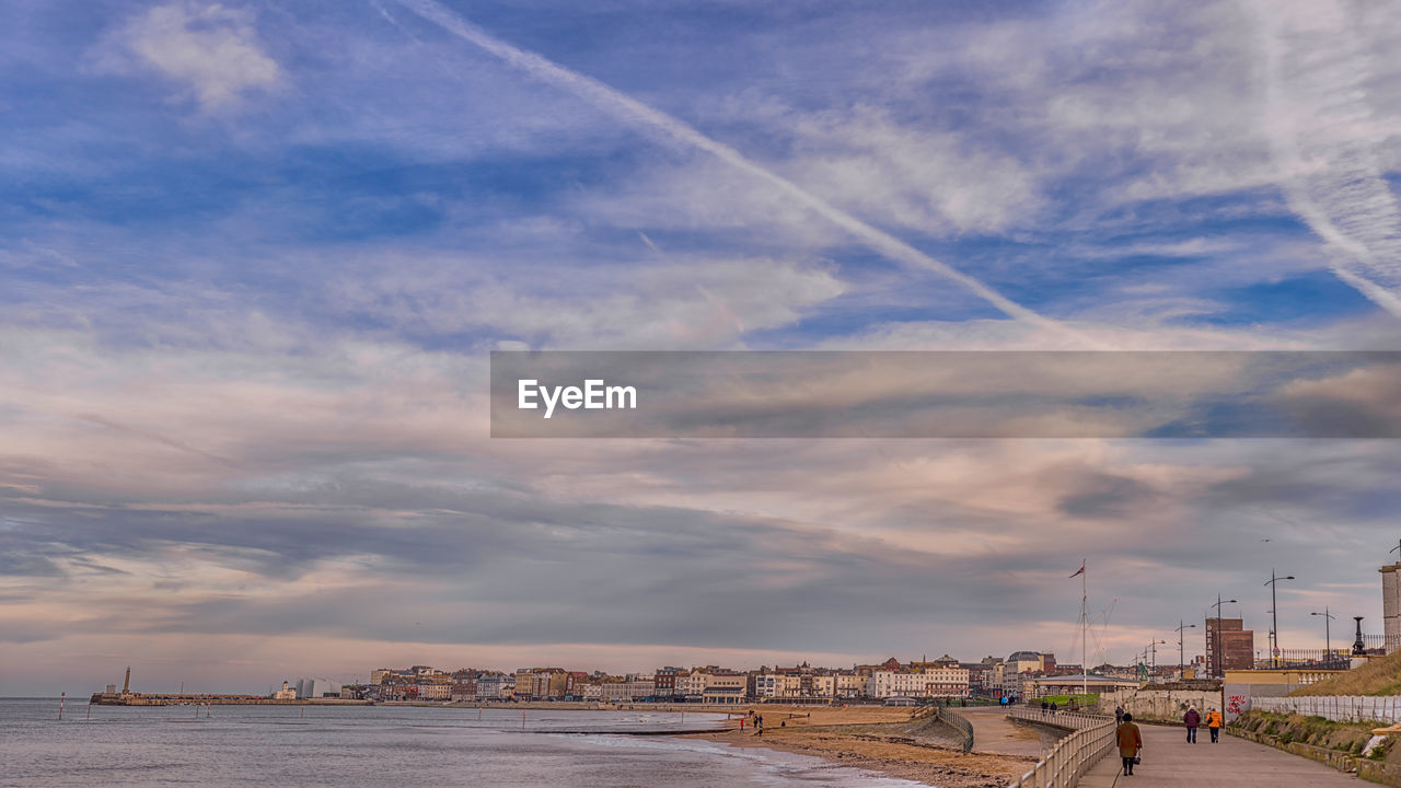 cloud - sky, sky, built structure, architecture, building exterior, nature, water, day, outdoors, city, sea, vapor trail, no people, cityscape