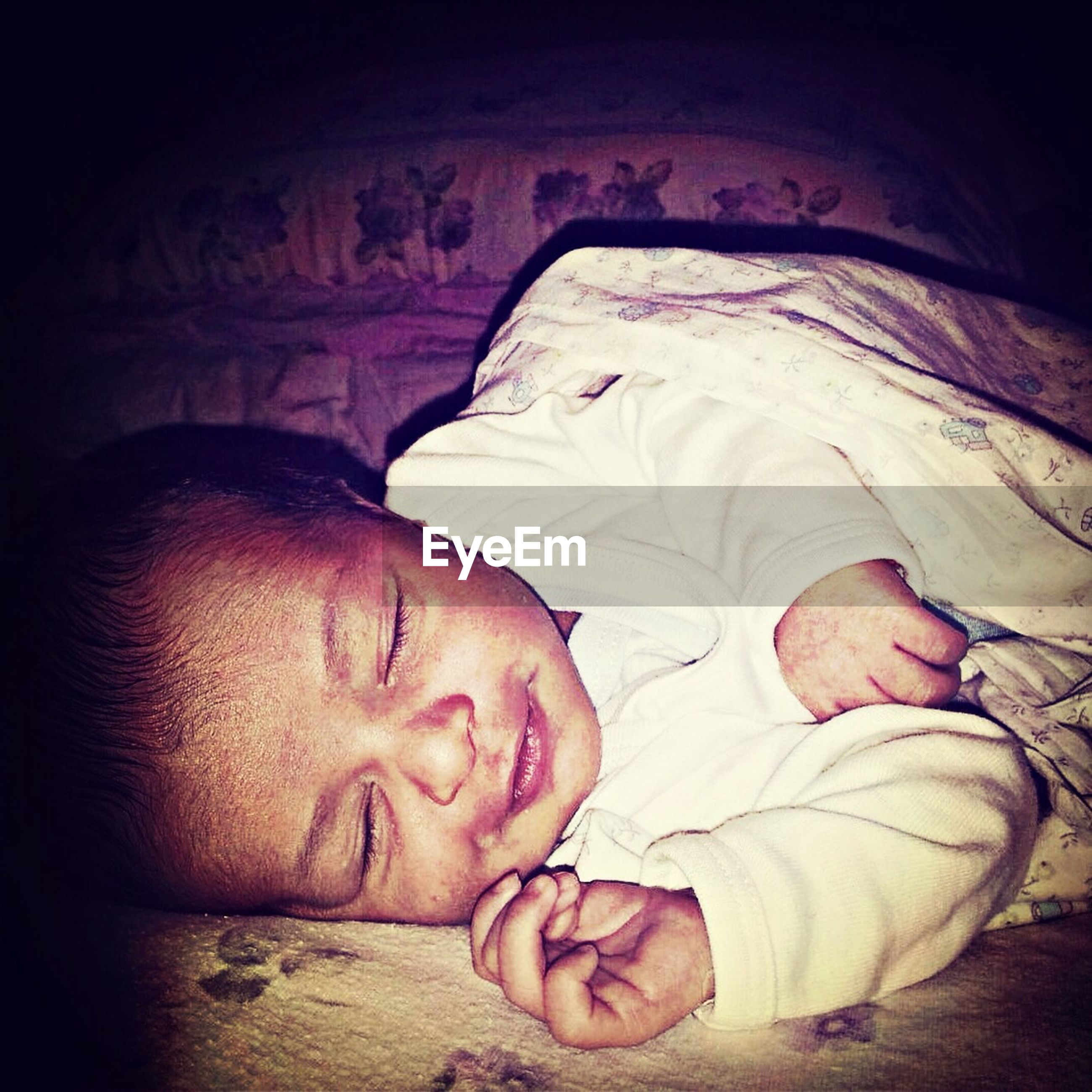 indoors, sleeping, relaxation, lifestyles, childhood, person, leisure activity, lying down, baby, innocence, casual clothing, eyes closed, love, bed, babyhood, bonding, togetherness, resting