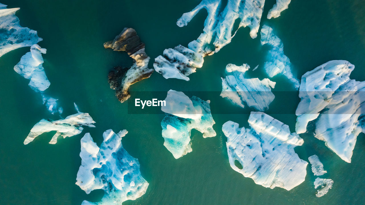 Aerial view of icebergs in sea during winter