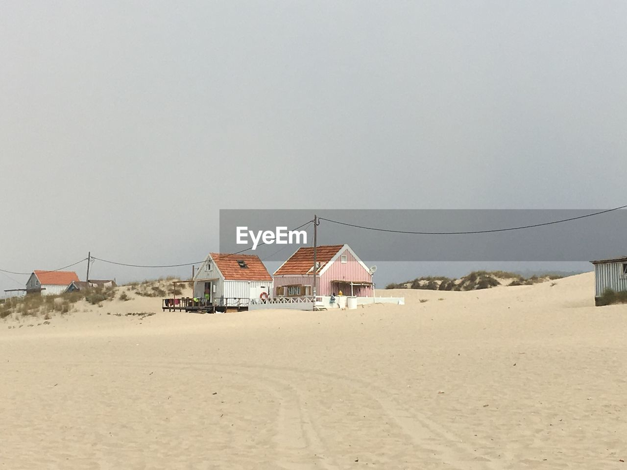 land, built structure, sand, architecture, sky, beach, nature, building exterior, copy space, day, no people, scenics - nature, clear sky, building, outdoors, landscape, hut, environment, house, tranquil scene, arid climate