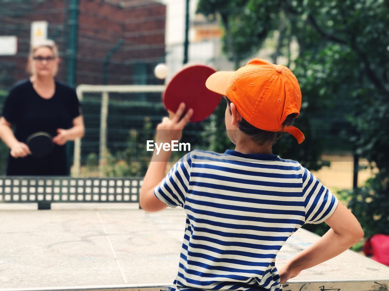 Boy playing table tennis