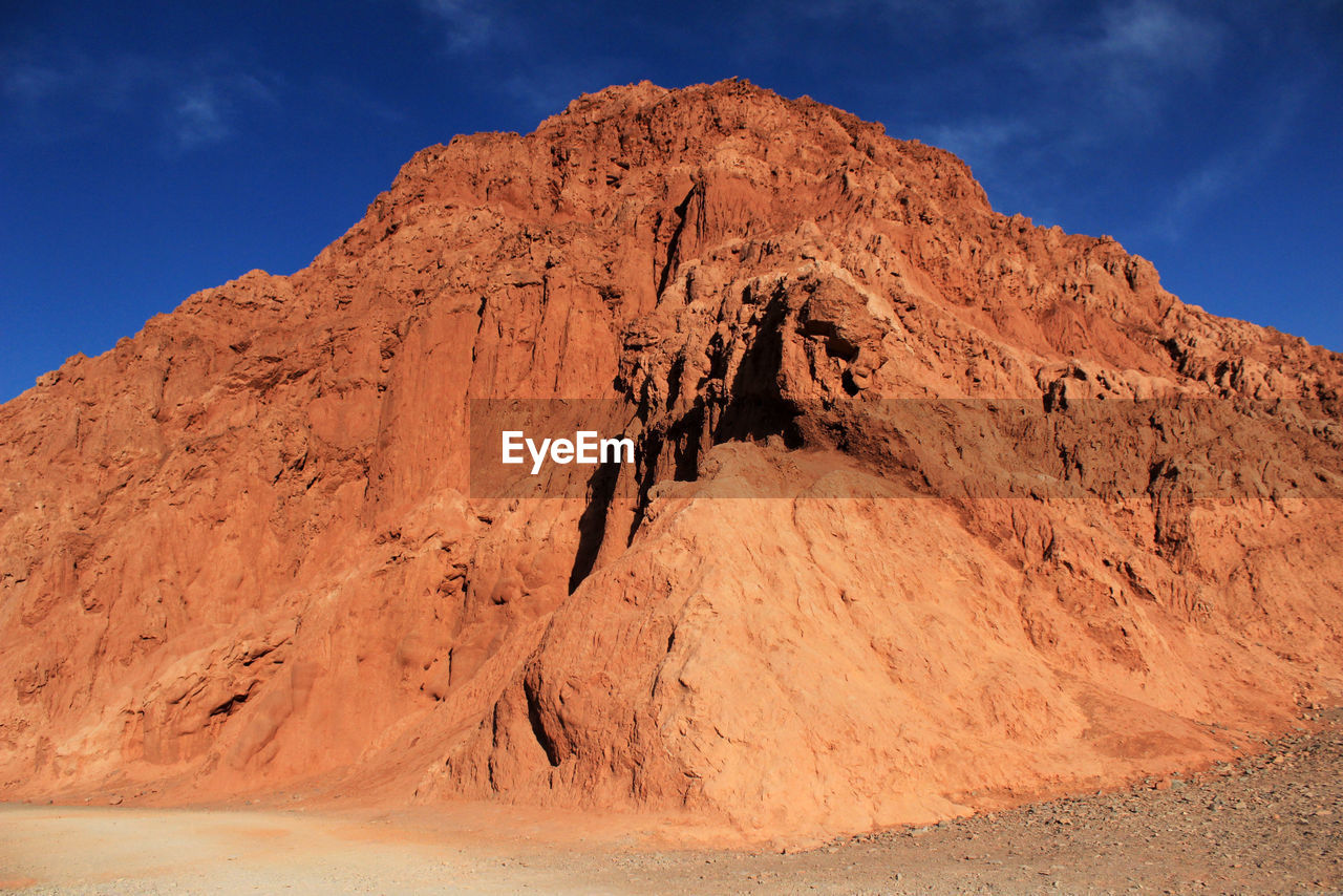 VIEW OF ROCK FORMATION AGAINST SKY