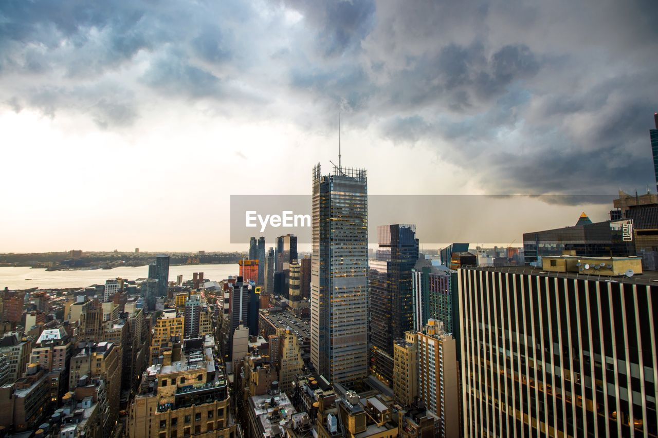 sky, building exterior, built structure, city, cloud - sky, architecture, building, cityscape, office building exterior, skyscraper, modern, tall - high, nature, crowd, office, residential district, landscape, outdoors, tower, financial district, apartment